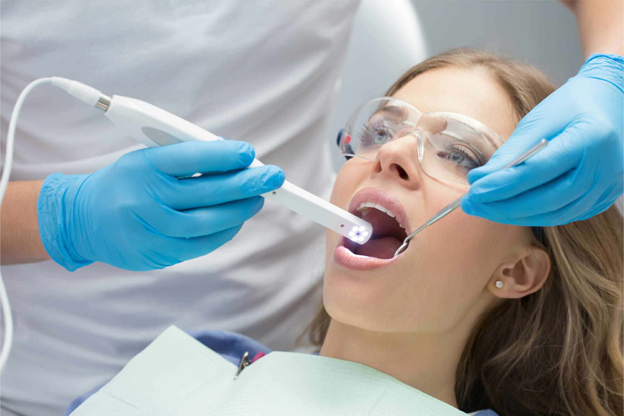 intra-oral camera in woman's mouth